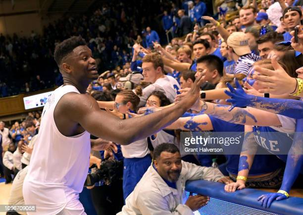 Zion Williamson of the Duke Blue Devils celebrates with the Cameron Crazies after a win against the Virginia Cavaliers at Cameron Indoor Stadium on...