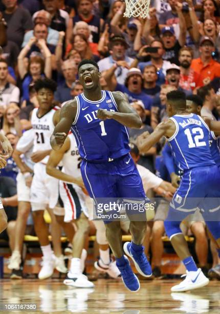 Zion Williamson of the Duke Blue Devils clinches his fist and lets out a yell after funking the ball during the second half of the game against the...
