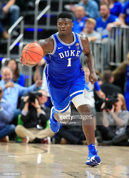 Zion Williamson of the Duke Blue Devils dribbles the ball against the kentucky Wildcats during the State Farm Champions Classic at Bankers Life...