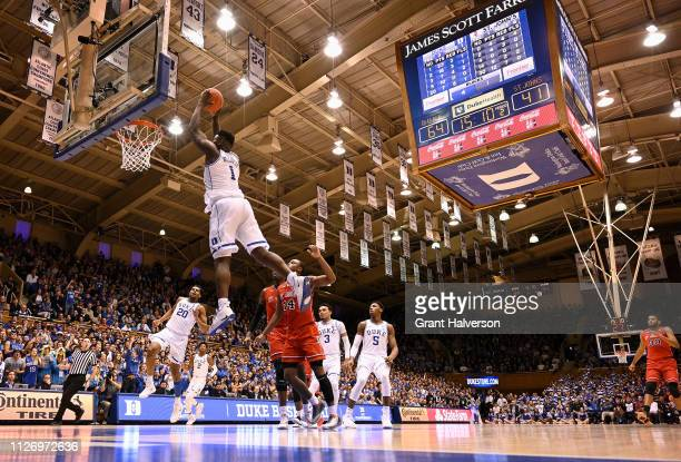 Zion Williamson of the Duke Blue Devils drives for a dunk against the St John's Red Storm during the second half of their game at Cameron Indoor...