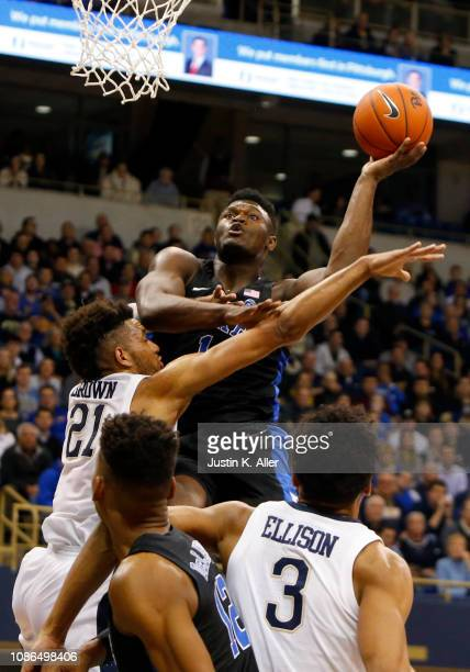 Zion Williamson of the Duke Blue Devils drives to the basket against Terrell Brown of the Pittsburgh Panthers at Petersen Events Center on January 22...