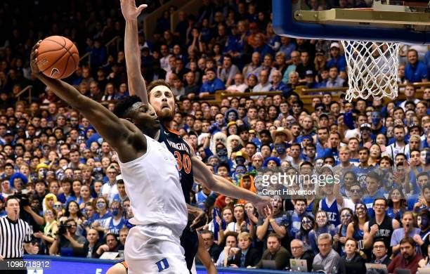 Zion Williamson of the Duke Blue Devils dunis over Jay Huff of the Virginia Cavaliers during their game at Cameron Indoor Stadium on January 19, 2019...