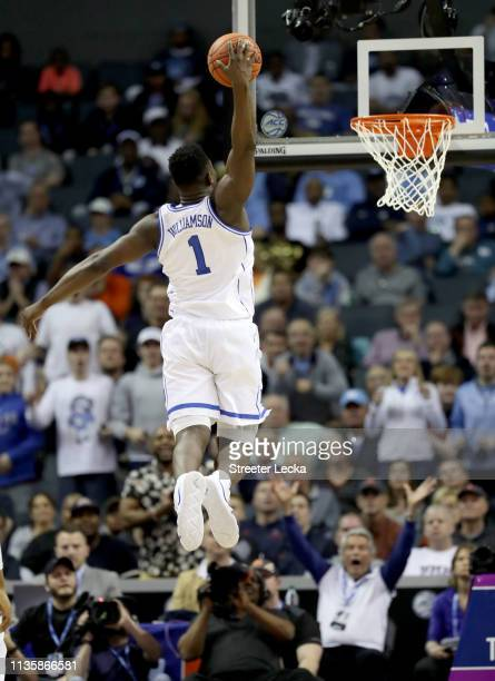 Zion Williamson of the Duke Blue Devils dunks his first ball after returning from injury against the Syracuse Orange during their game in the...