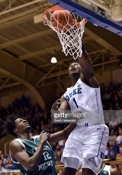Zion Williamson of the Duke Blue Devils dunks over Boubacar Toure of the Eastern Michigan Eagles during the first half of their game at Cameron...