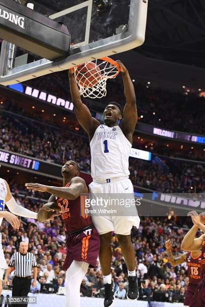 Zion Williamson of the Duke Blue Devils dunks over Ty Outlaw of the Virginia Tech Hokies in the third round of the 2019 NCAA Photos via Getty Images...