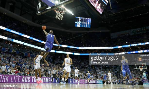 Zion Williamson of the Duke Blue Devils dunks the ball against the North Carolina Tar Heels during their game in the semifinals of the 2019 Men's ACC...