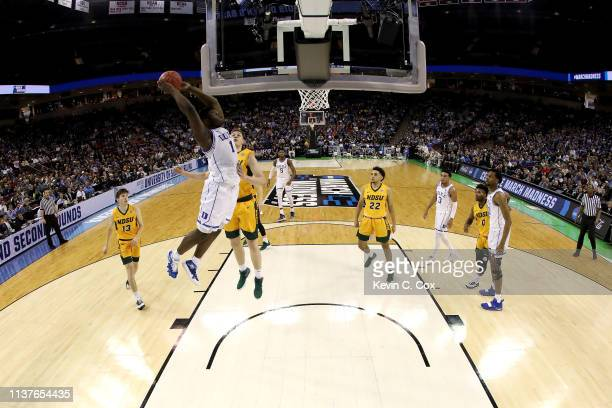 Zion Williamson of the Duke Blue Devils dunks the ball in the first half during the first round of the 2019 NCAA Men's Basketball Tournament at...