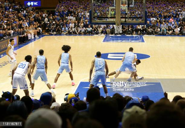 Zion Williamson of the Duke Blue Devils falls as his shoe breaks against Luke Maye of the North Carolina Tar Heels during their game at Cameron...