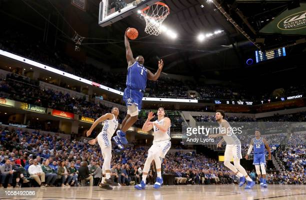 Zion Williamson of the Duke Blue Devils goes up to dunk the ball against the kentucky Wildcats during the State Farm Champions Classic at Bankers...