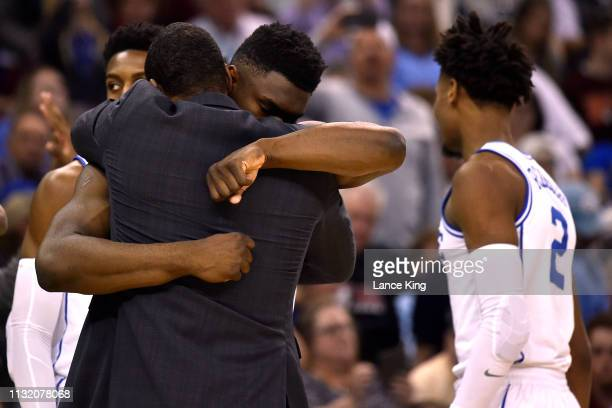 Zion Williamson of the Duke Blue Devils hugs associate head coach Nate James prior to their game against the North Dakota State Bison during the...