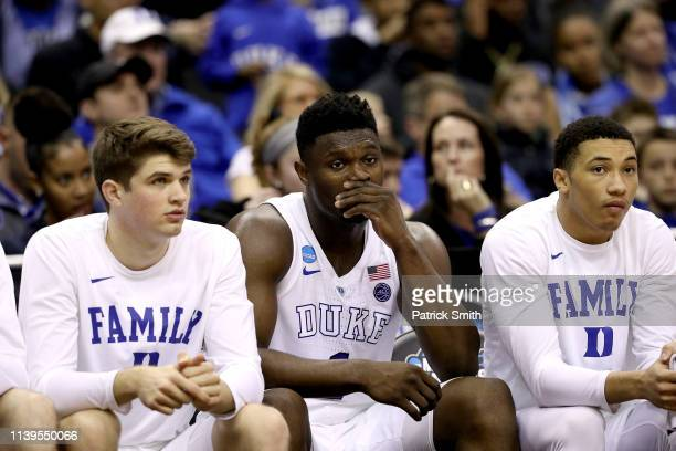 Zion Williamson of the Duke Blue Devils looks on from the bench against the Michigan State Spartans during the first half in the East Regional game...