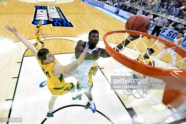 Zion Williamson of the Duke Blue Devils puts up a shot over Rocky Kreuser of the North Dakota State Bison in the first round of the 2019 NCAA Men's...