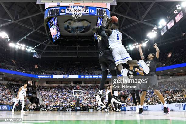 Zion Williamson of the Duke Blue Devils puts up a shot over Tacko Fall of the UCF Knights in the second round of the 2019 NCAA Photos via Getty...