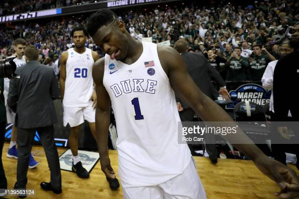 Zion Williamson of the Duke Blue Devils reacts after being defeated by the Michigan State Spartans in the East Regional game of the 2019 NCAA Men's...