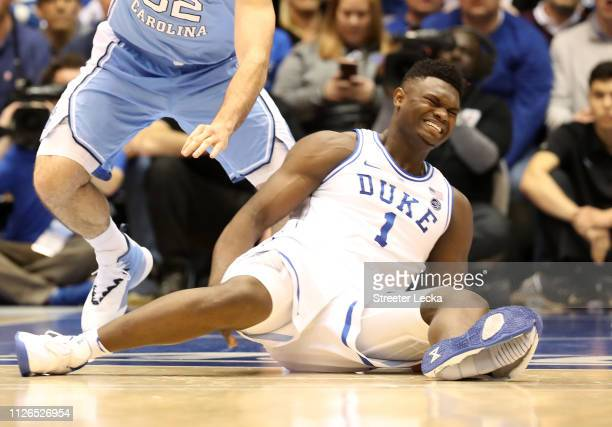 Zion Williamson of the Duke Blue Devils reacts after falling as his shoe breaks in the first half of the game against the North Carolina Tar Heels at...