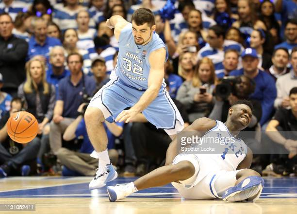 Zion Williamson of the Duke Blue Devils reacts after falling as his shoe breaks against Luke Maye of the North Carolina Tar Heels during their game...