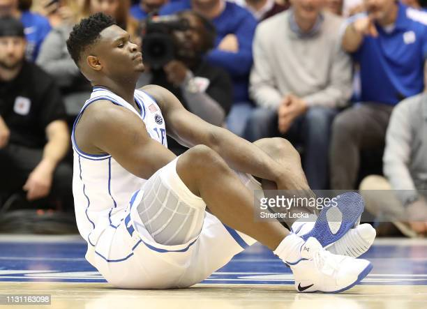 Zion Williamson of the Duke Blue Devils reacts after falling as his shoe breaks during their game against the North Carolina Tar Heels at Cameron...
