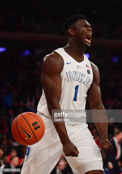 Zion Williamson of the Duke Blue Devils reacts after making a slam dunk during the first half of the game against Texas Tech Red Raiders during the...