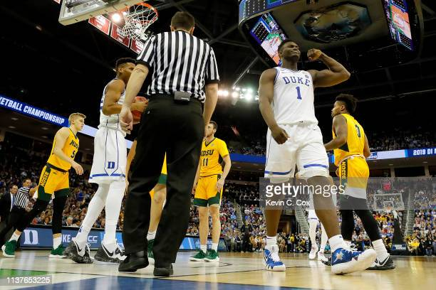 Zion Williamson of the Duke Blue Devils reacts after scoring a basket and drawing a foul against the North Dakota State Bison in the second half...