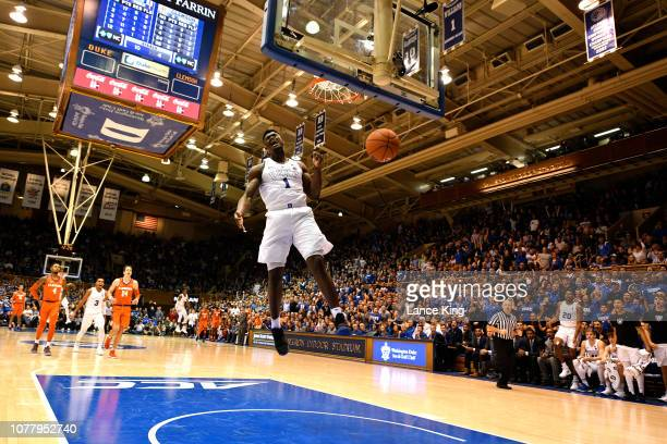 Zion Williamson of the Duke Blue Devils reacts following a 360degree dunk against the Clemson Tigers in the second half at Cameron Indoor Stadium on...