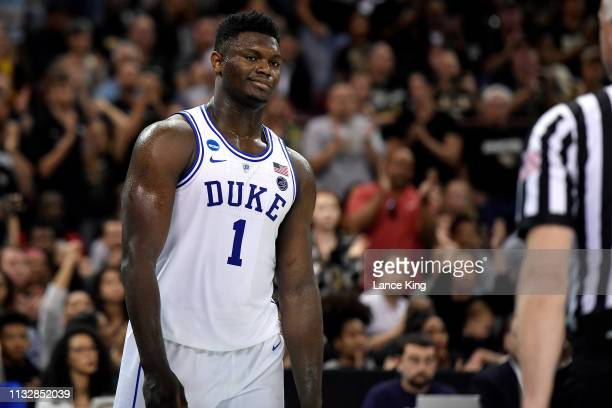 Zion Williamson of the Duke Blue Devils reacts following a play in the first half against the Central Florida Knights during the second round of the...