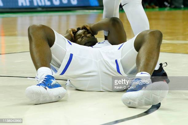 Zion Williamson of the Duke Blue Devils reacts from the ground against the UCF Knights during the second half in the second round game of the 2019...