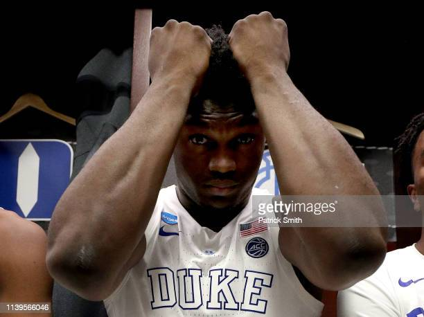 Zion Williamson of the Duke Blue Devils reacts in the locker room after his teams 6867 loss to the Michigan State Spartans in the East Regional game...