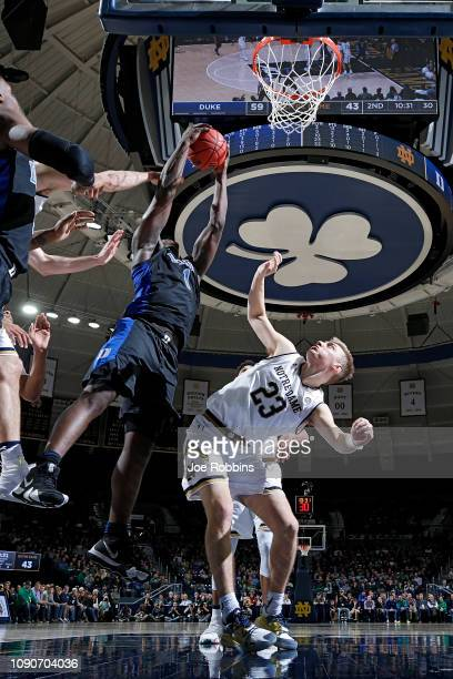 Zion Williamson of the Duke Blue Devils rebounds over Dane Goodwin of the Notre Dame Fighting Irish in the second half of the game at Purcell...