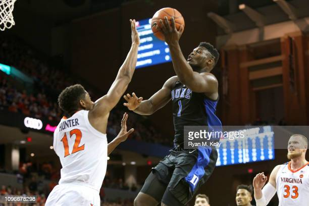 Zion Williamson of the Duke Blue Devils shoots over De'Andre Hunter of the Virginia Cavaliers in the first half during a game at John Paul Jones...