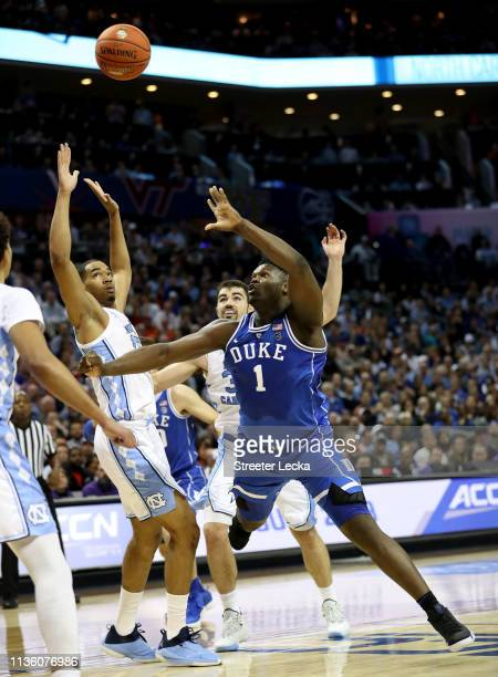 Zion Williamson of the Duke Blue Devils shoots over Garrison Brooks of the North Carolina Tar Heels during their game in the semifinals of the 2019...