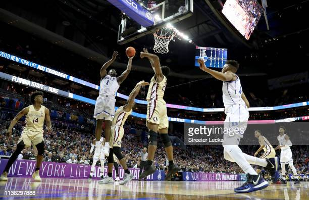 Zion Williamson of the Duke Blue Devils shoots over Mfiondu Kabengele of the Florida State Seminoles during the championship game of the 2019 Men's...