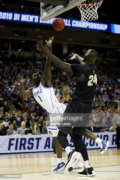 Zion Williamson of the Duke Blue Devils shoots the ball against Tacko Fall of the UCF Knights during the first half in the second round game of the...