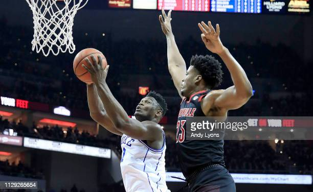Zion Williamson of the Duke Blue Devils shoots the ball against the Louisville Cardinals at KFC YUM Center on February 12 2019 in Louisville Kentucky