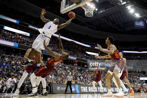 Zion Williamson of the Duke Blue Devils shoots the ball against the Virginia Tech Hokies during the second half in the East Regional game of the 2019...
