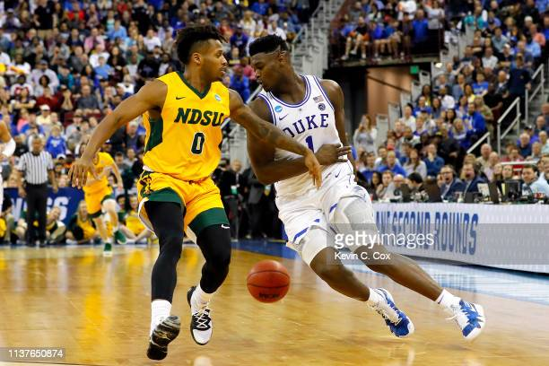 Zion Williamson of the Duke Blue Devils steals the ball from Vinnie Shahid of the North Dakota State Bison in the second half during the first round...
