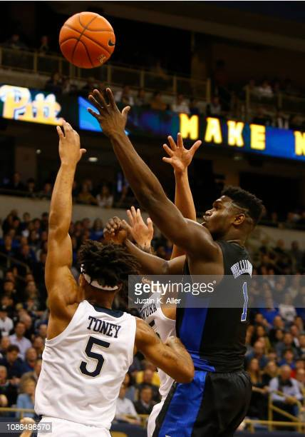 Zion Williamson of the Duke Blue Devils takes a shot against Au'Diese Toney of the Pittsburgh Panthers at Petersen Events Center on January 22 2019...