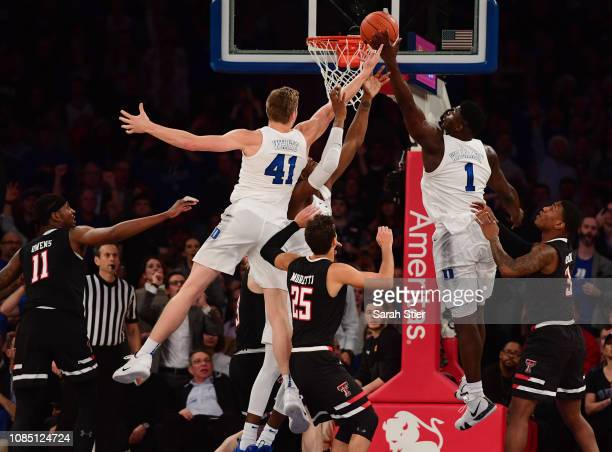 Zion Williamson of the Duke Blue Devils tips the ball into the basket during the second half of the game against Texas Tech Red Raiders during the...