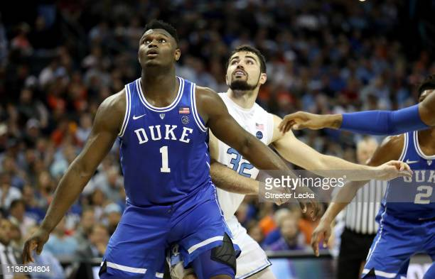 Zion Williamson of the Duke Blue Devils waits for a rebound with Luke Maye of the North Carolina Tar Heels during their game in the semifinals of the...