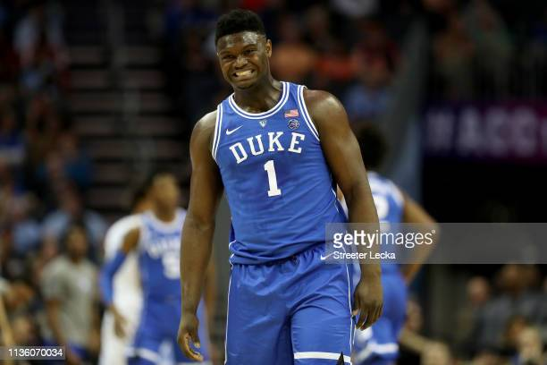 Zion Williamson of the Duke Blue Devils winces against the North Carolina Tar Heels during their game in the semifinals of the 2019 Men's ACC...