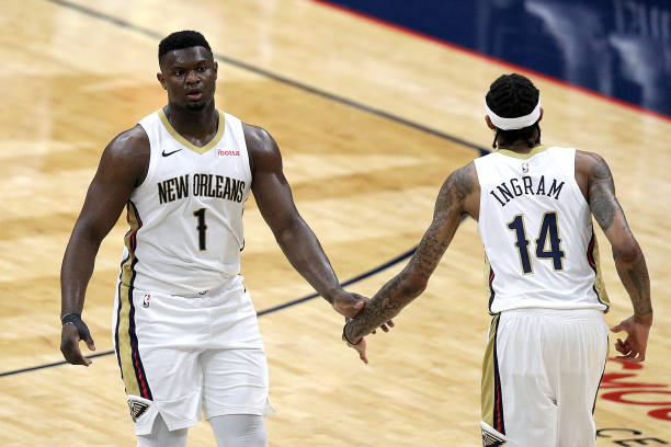 Zion Williamson of the New Orleans Pelicans and Brandon Ingram of the New Orleans Pelicans react after scoring during the third quarter of an NBA...