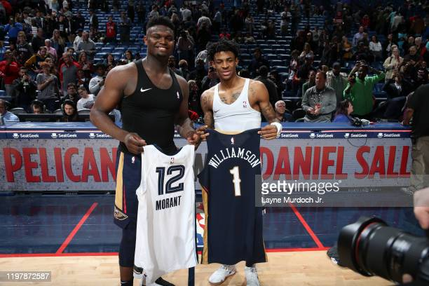 Zion Williamson of the New Orleans Pelicans and Ja Morant of the Memphis Grizzlies swap jerseys after the game on January 31 2020 at the Smoothie...