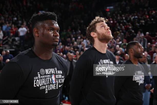 Zion Williamson of the New Orleans Pelicans and Nicolo Melli of the New Orleans Pelicans look on before the game against the Portland Trail Blazers...
