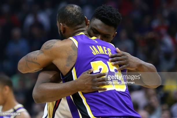 Zion Williamson of the New Orleans Pelicans as LeBron James of the Los Angeles Lakers embrace before the first half at the Smoothie King Center on...