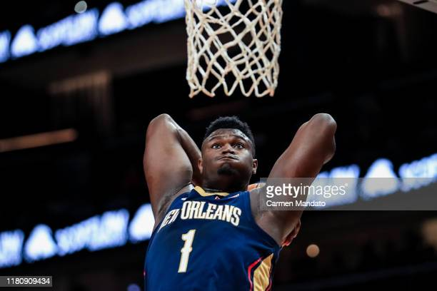 Zion Williamson of the New Orleans Pelicans attempts to dunk a ball during a preseason game against the Atlanta Hawks at State Farm Arena on October...