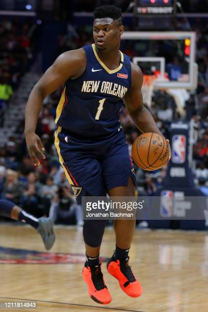 Zion Williamson of the New Orleans Pelicans drives with the ball against the Miami Heat during a game at the Smoothie King Center on March 06 2020 in...
