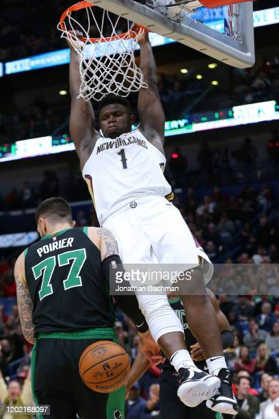 Zion Williamson of the New Orleans Pelicans dunks over Vincent Poirier of the Boston Celtics during the second half at the Smoothie King Center on...