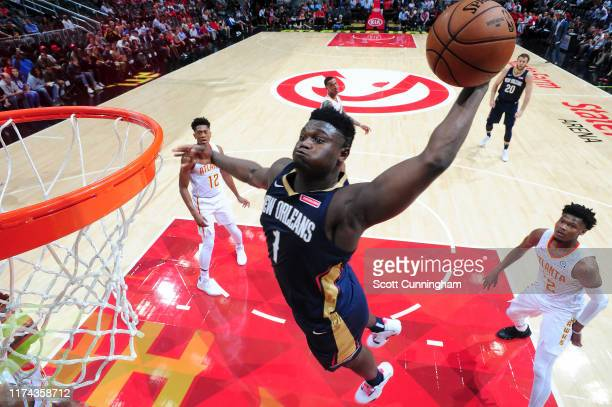 Zion Williamson of the New Orleans Pelicans dunks the ball against the Atlanta Hawks during a preseason game on October 7 2019 at State Farm Arena in...