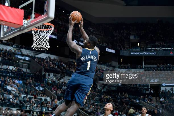 Zion Williamson of the New Orleans Pelicans dunks the ball against the San Antonio Spurs during a preseason game on October 13 2019 at the ATT Center...