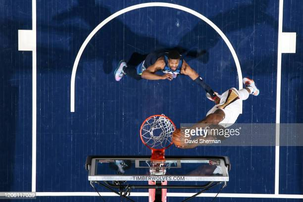 Zion Williamson of the New Orleans Pelicans dunks the ball against the Minnesota Timberwolves on March 8 2020 at Target Center in Minneapolis...