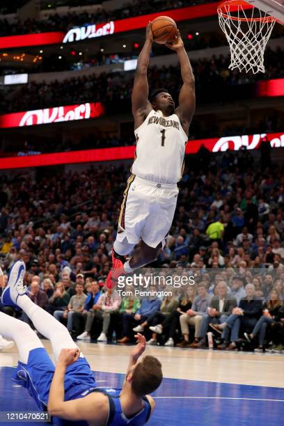 Zion Williamson of the New Orleans Pelicans dunks the ball against Maxi Kleber of the Dallas Mavericks in the third quarter at American Airlines...